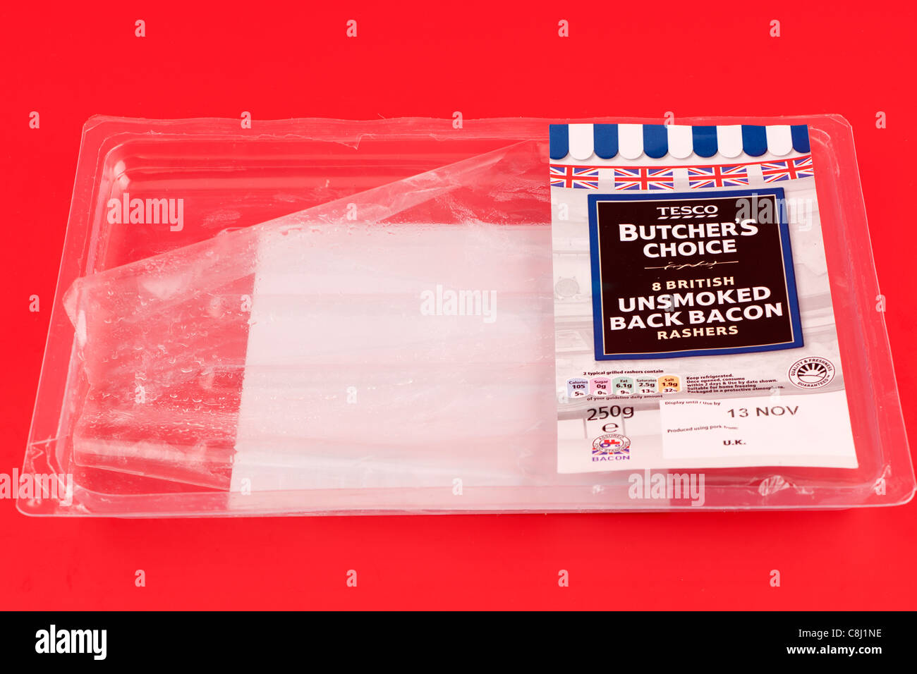 Empty clear plastic packaging tray for rashers of bacon - Stock Image