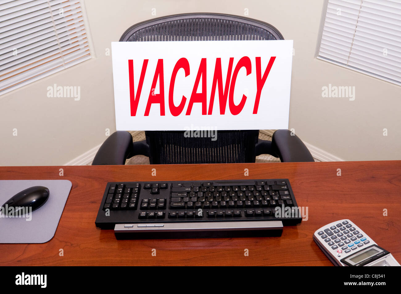 Desk with a Vacancy sign. Your text in the blank name plate. Great for employment/HR/unemployment themes. - Stock Image
