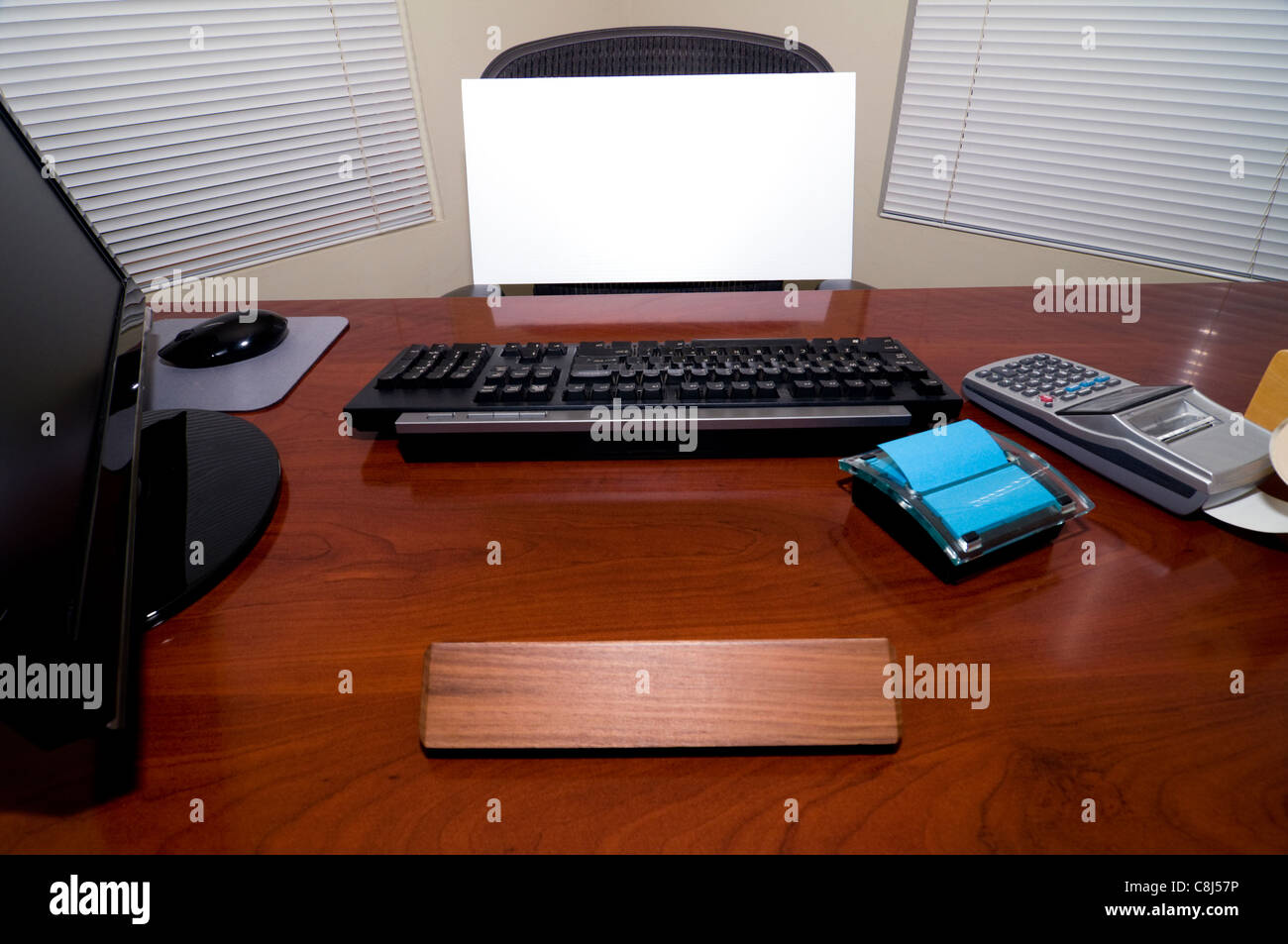 An Office Desk with a Blank Sign Board in the Chair. Add Your Text to Express Numerous Business and Employment Issues! - Stock Image