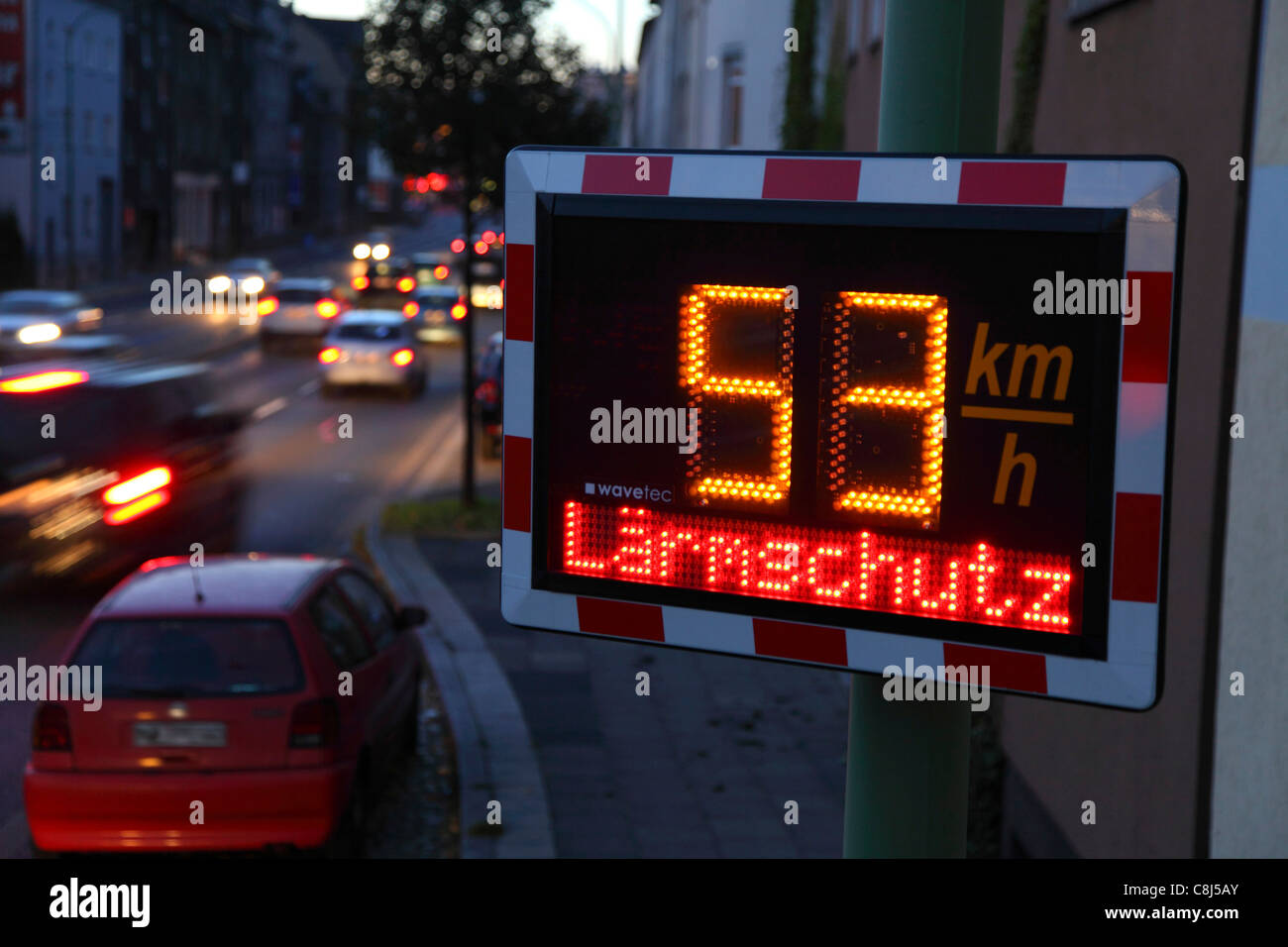 Speed display at a busy street in the city of Essen, Germany. Shows the speed of passing cars. Speed limit is 50 Stock Photo