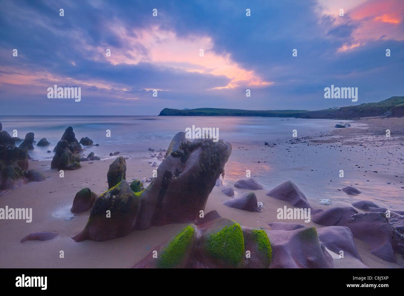 rugged coastline at sunset on Dingle Peninsula, Co.Kerry, Ireland - Stock Image