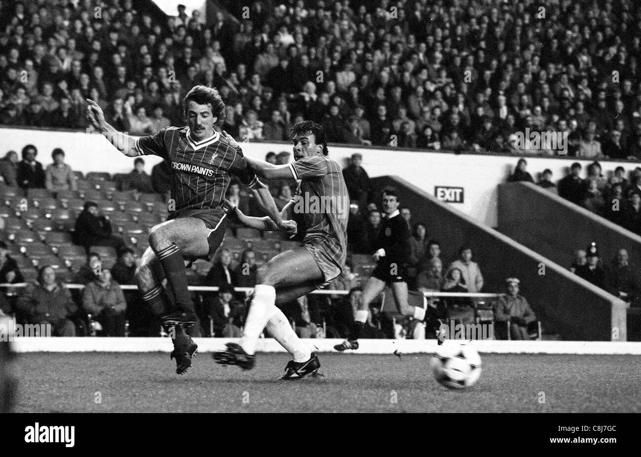 Liverpool V Walsall Town at Anfield 7/2/1984 Liverpools Alan Kennedy and Walsall player Mark Rees - Stock Image
