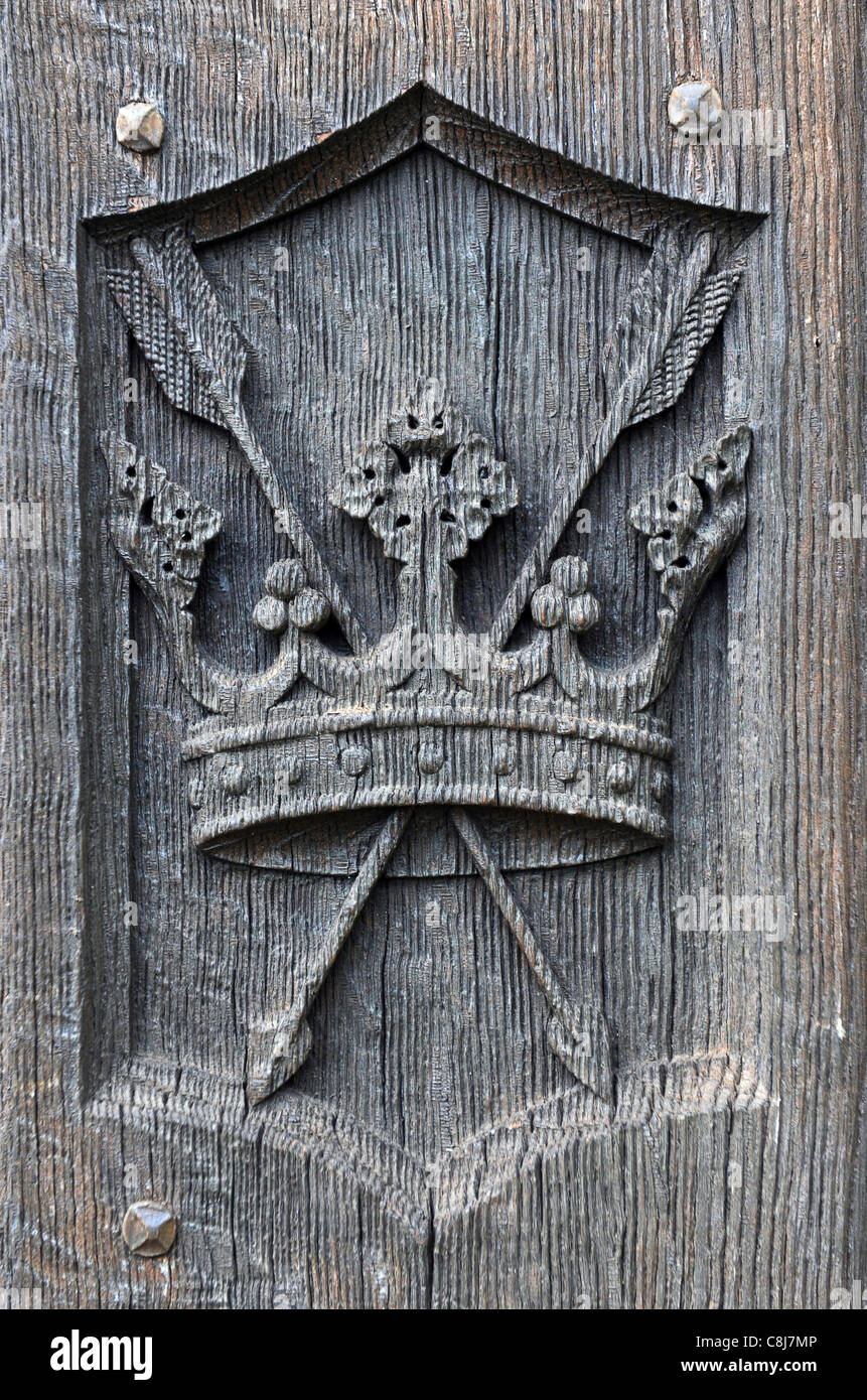 St Edmund's Crown and Arrows carved on the doors St Edmund Church at Fritton in Norfolk which was formerly in - Stock Image