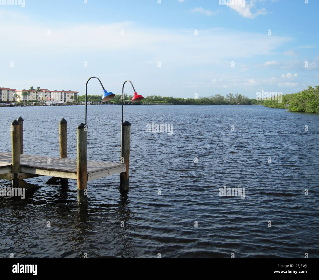 old wooden boat dock by an inlet in Naples Florida Stock Photo