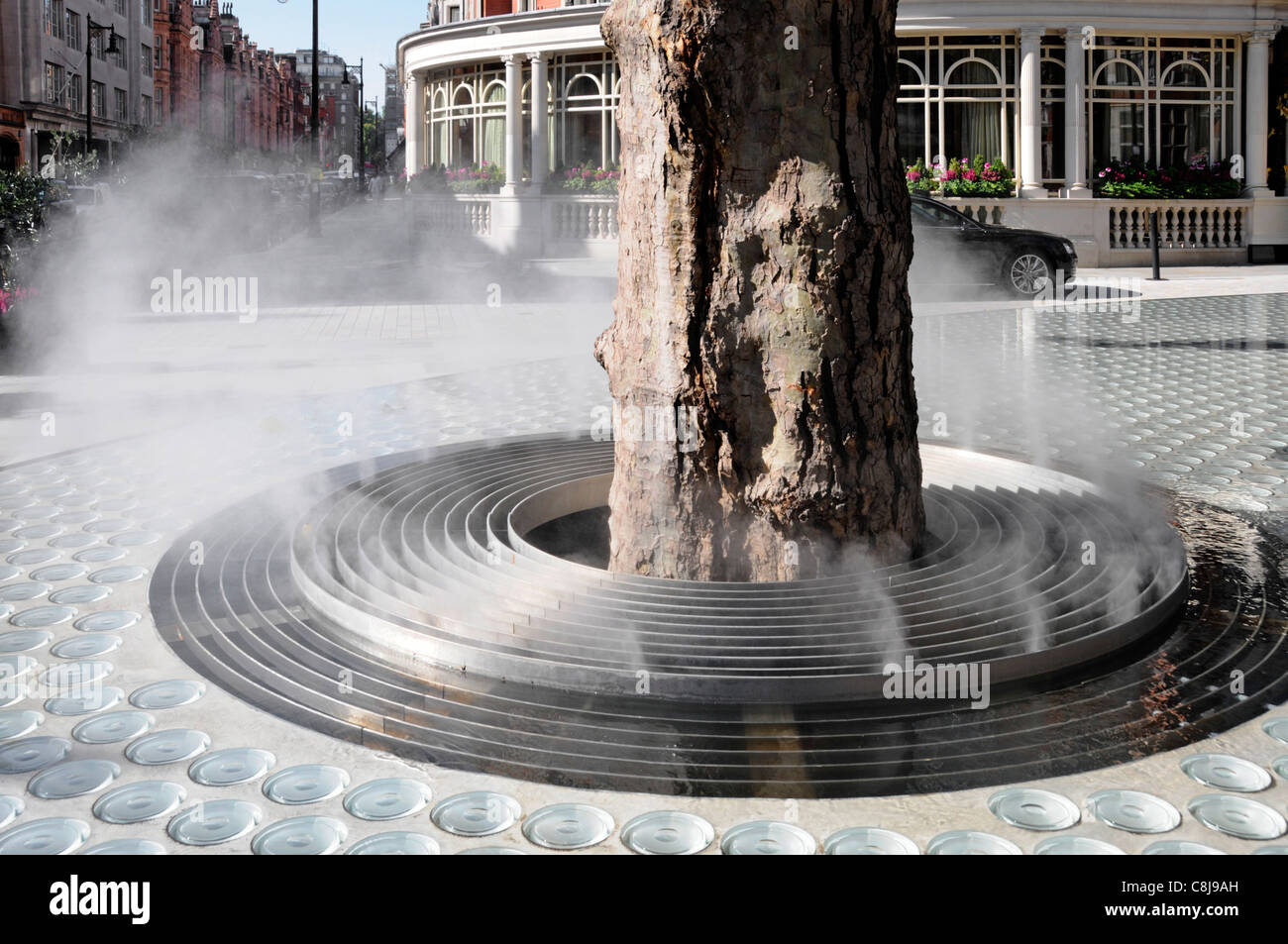Close up of grill around tree trunk for atomiser to create steam mist vapour cloud to drift over Tadao Ando 'Silence' - Stock Image