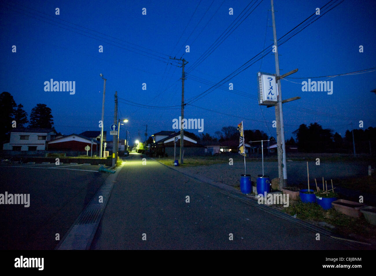 Streets are deserted inside the evacuation zone in Tomioka, Fukushima Prefecture, Japan - Stock Image
