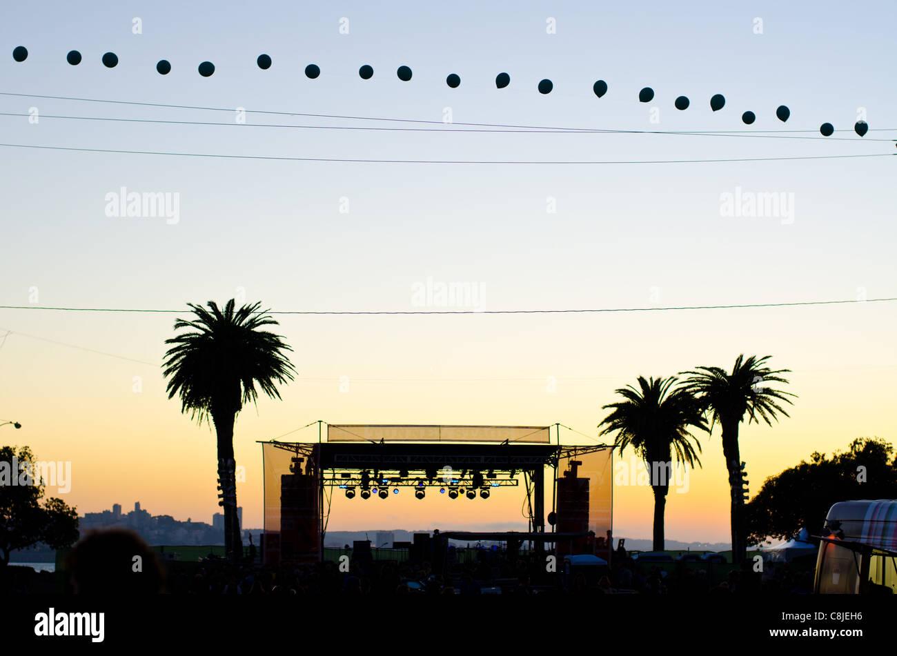Suntset behind the stage at Treasure Island Music festival, San Francisco, California - Stock Image