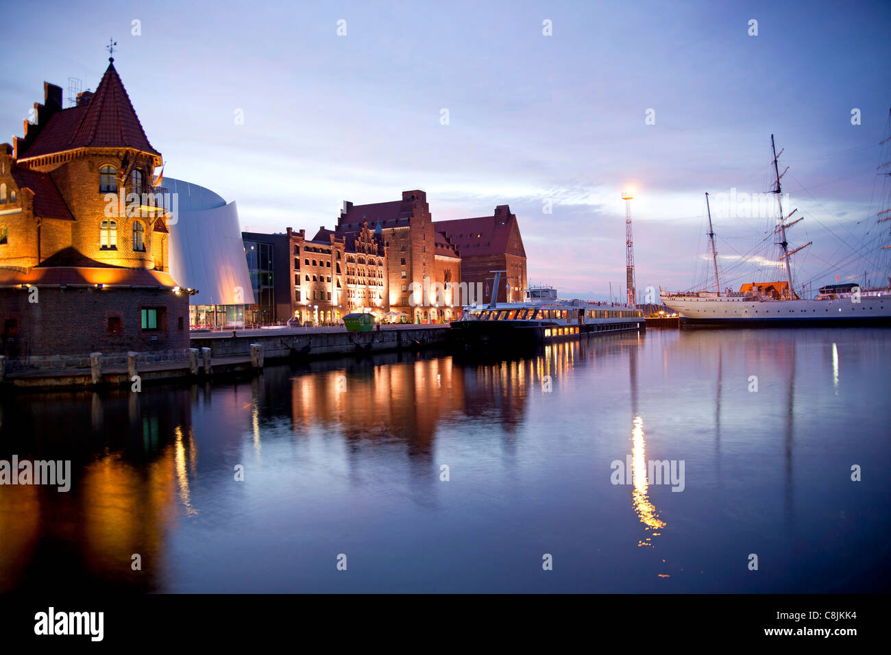 blue hour at the harbor with Maritime pilots building, Ozeaneum and the three-mast barque Gorch Fock 1 in Stralsun - Stock Image