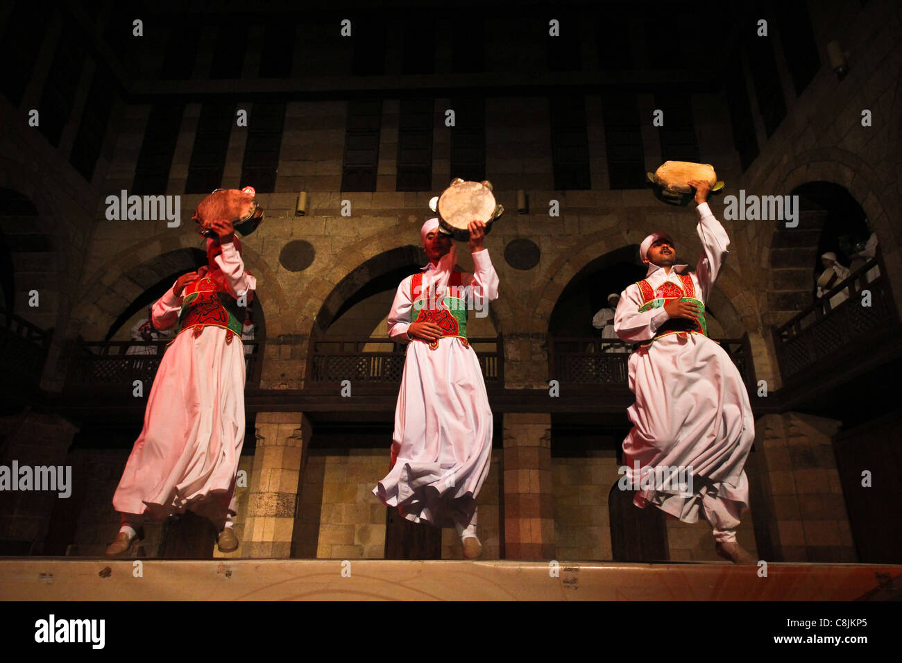 Dervishes perform at the Ghouriyya in Old Cairo Egypt - Stock Image