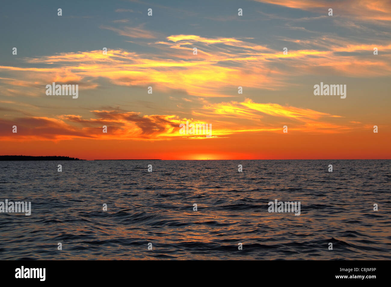 sunset on lake - Stock Image