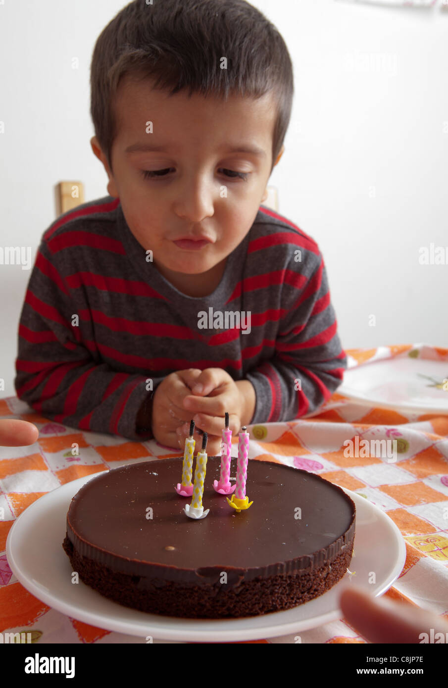 3 Years Old Boy Looking At His Birthday Cake