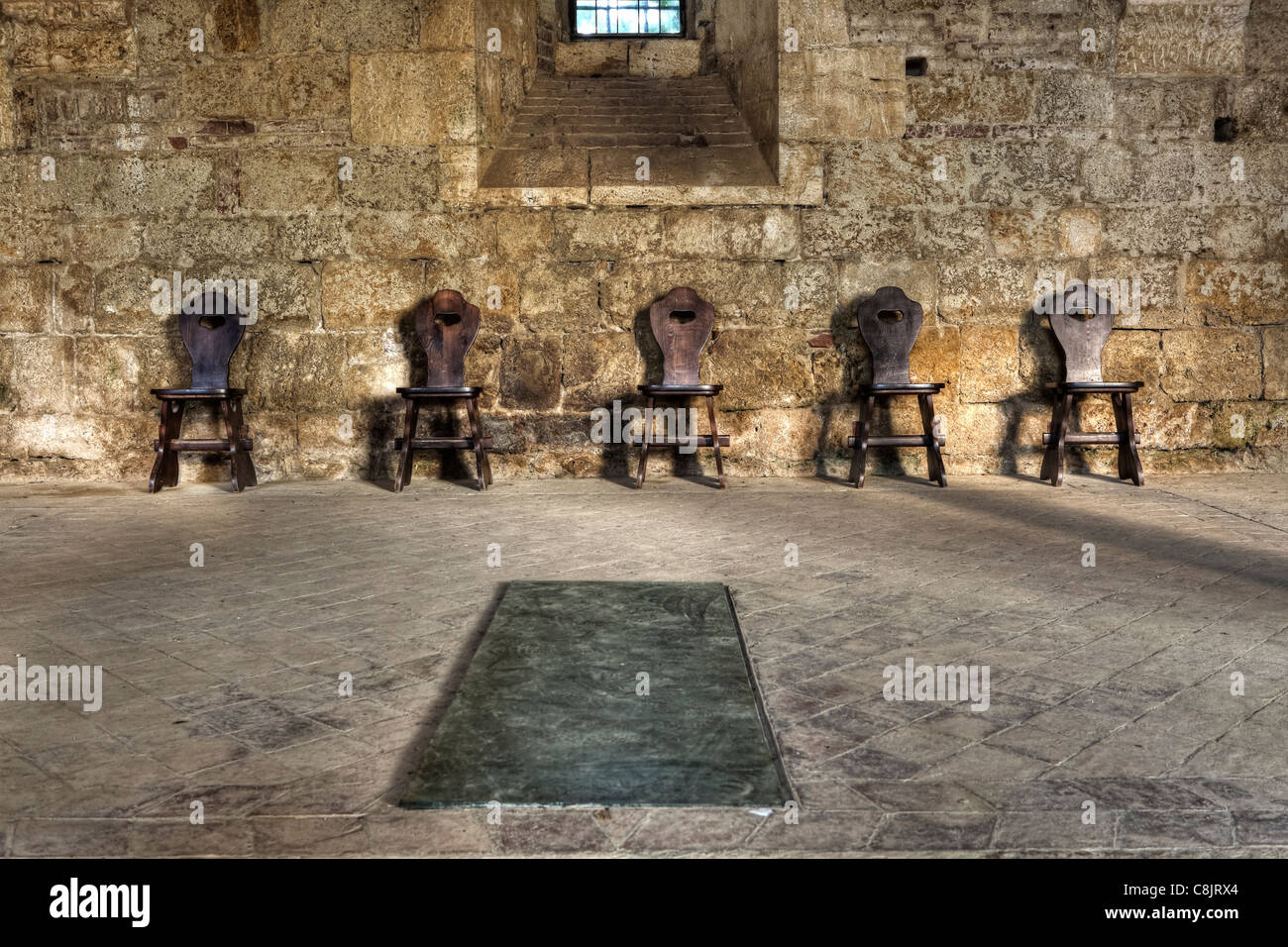 five chairs in an old abbey - Stock Image