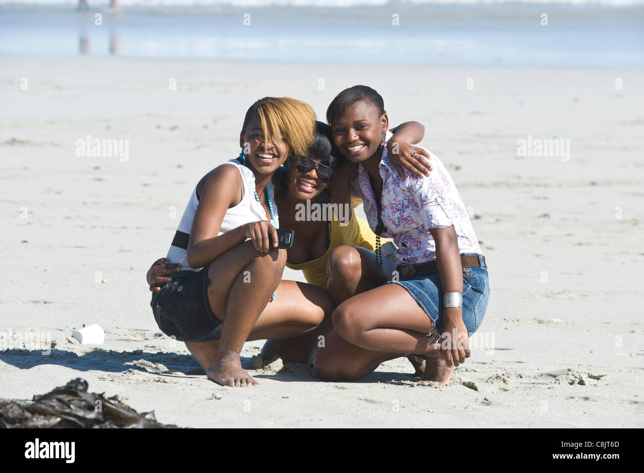 Teenager friends on Grotto Beach Western Cape South Africa Stock Photo