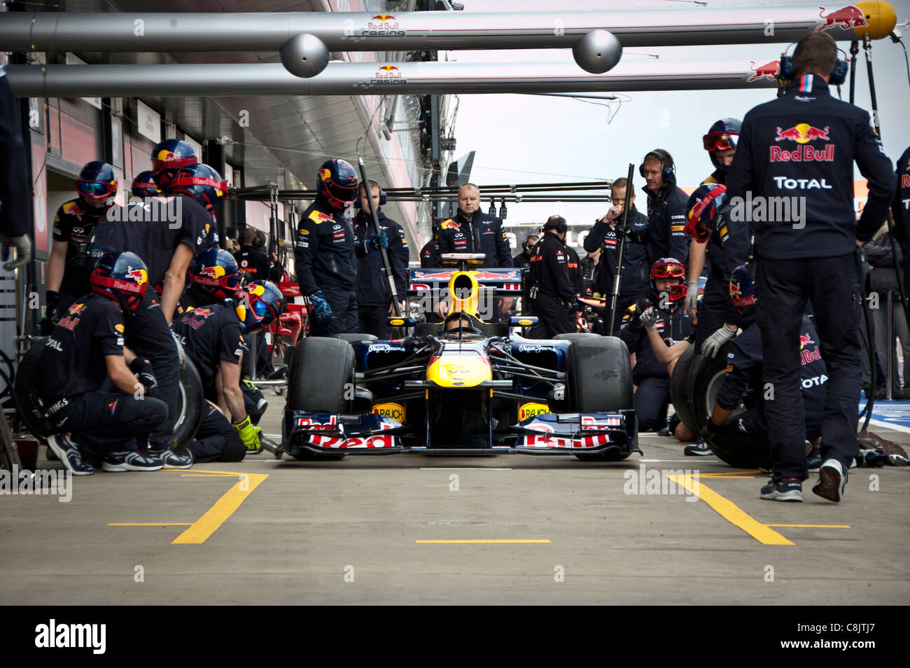 Red Bull mechanics practice pit stop ahead of British Formula One Grand Pix - Stock Image