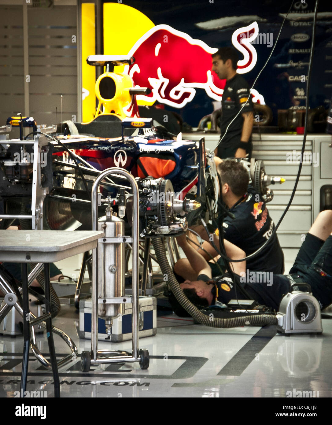 Red Bull mechanics working on Formula one racing car - Stock Image