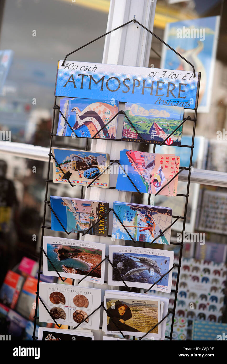postcards on a stand in the holiday town of Lyme Regis, Dorset. - Stock Image