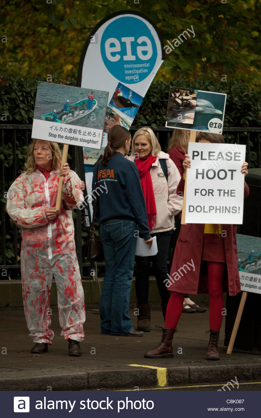 Londoners: Save the Dolphins Protest rally at Japanese embassy in London - Stock Image