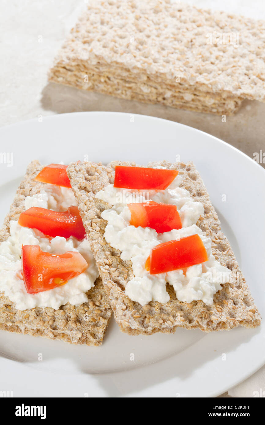 Ryvita Crispbread with cottage cheese and tomato - Stock Image