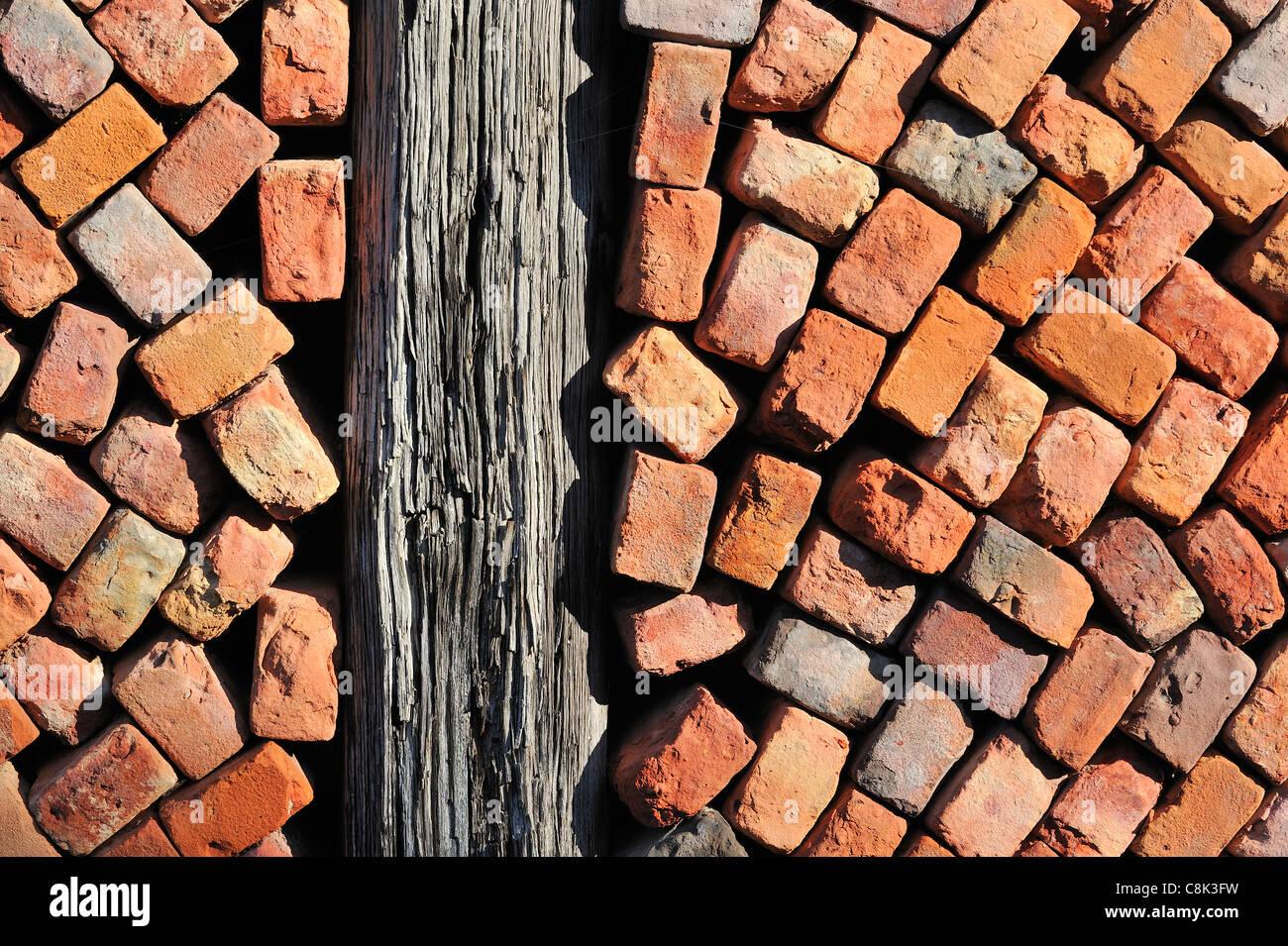 Stacked red bricks as building material at brickworks, Boom, Belgium - Stock Image