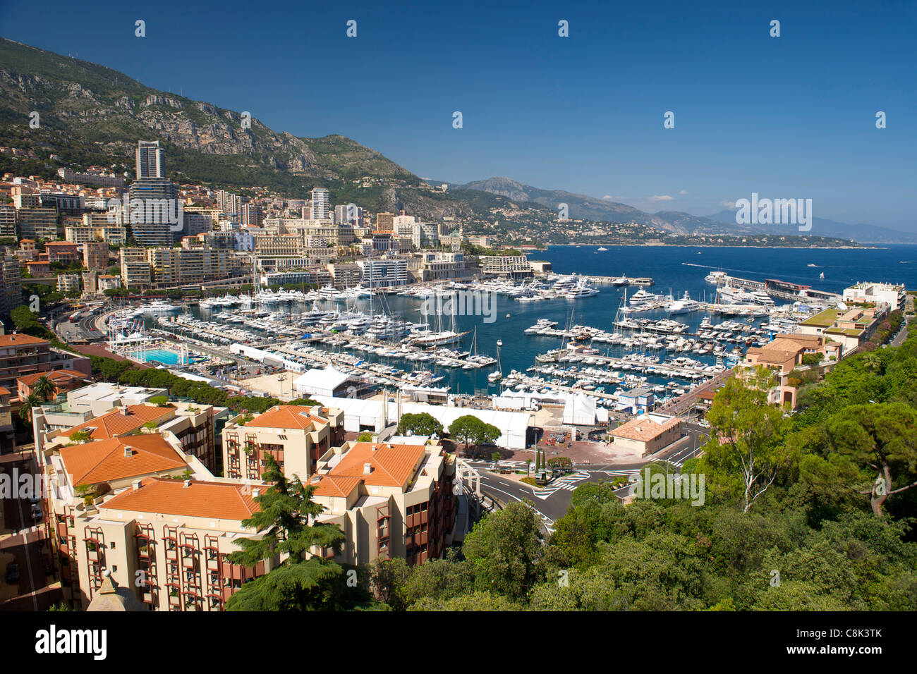 View of Port Hercule and the city and Principality of Monaco on the French Riviera along the Mediterranean coast. - Stock Image