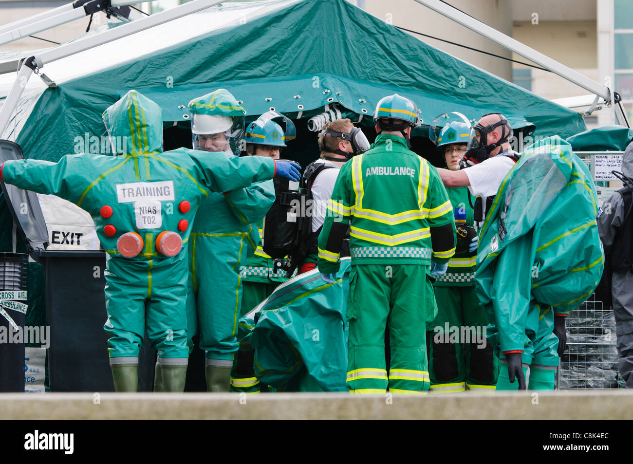 Paramedics change into protective suits during the launch of Northern Ireland Ambulance Service (NIAS) Hazardous - Stock Image
