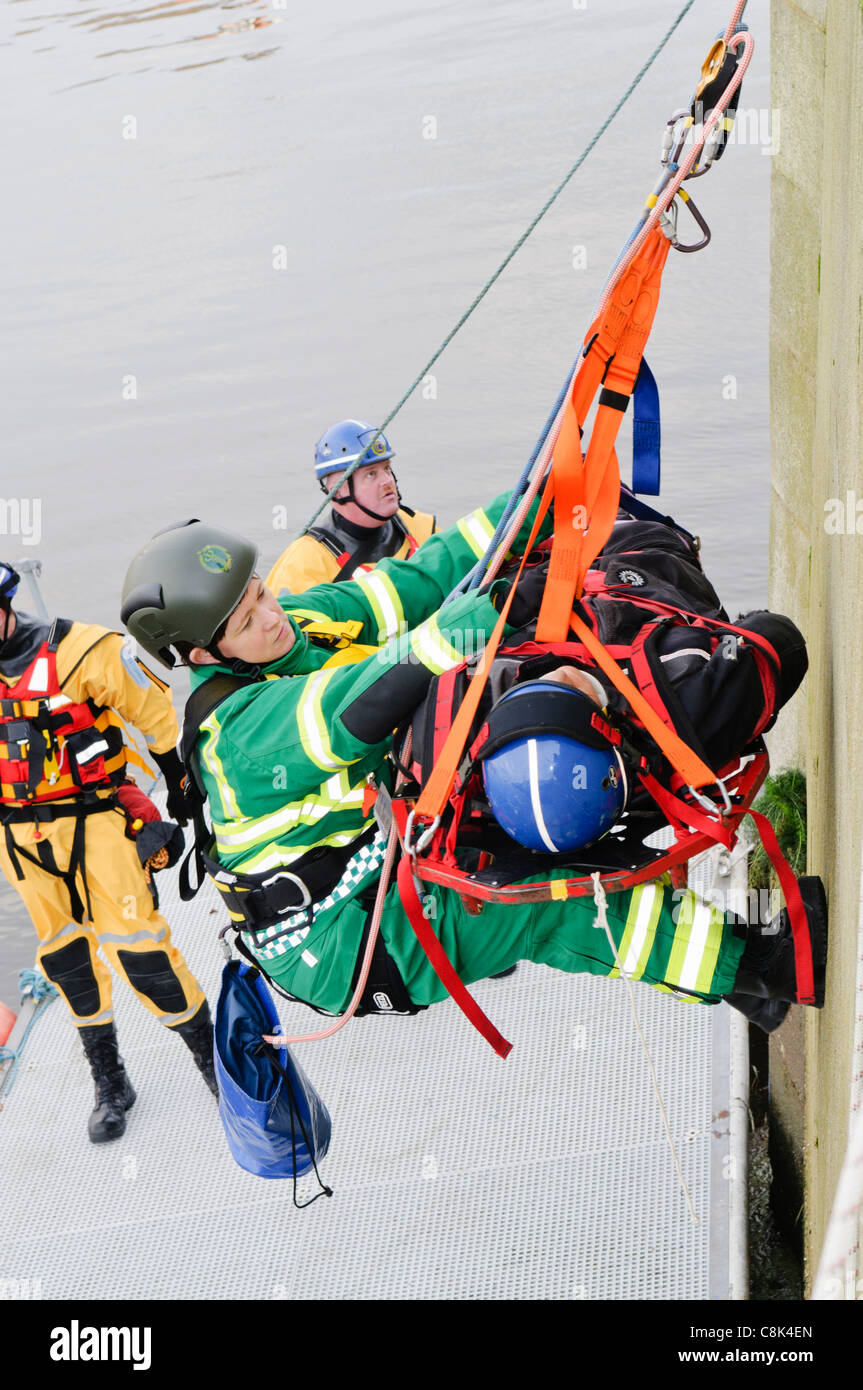 Paramedic is winched up on a rope with a patient during the launch of Northern Ireland Ambulance Service (NIAS) - Stock Image