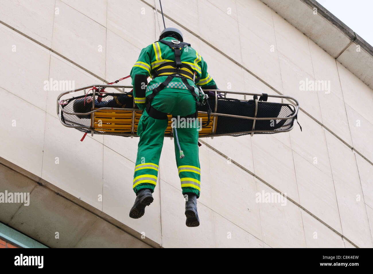 Paramedic is winched down a building on a rope with a patient during the launch of Northern Ireland Ambulance Service - Stock Image