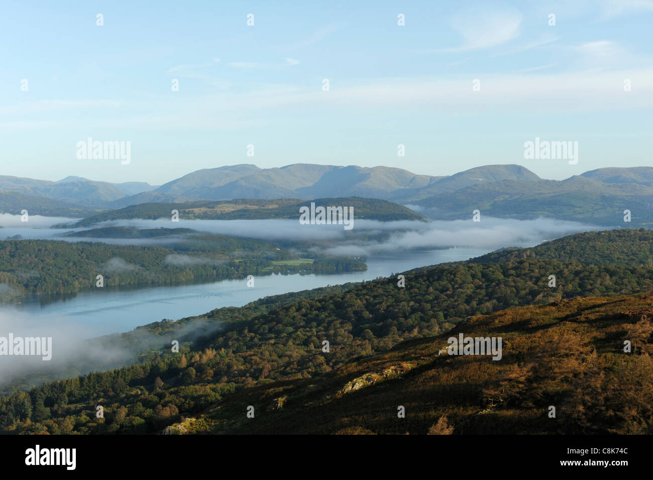 View from Gummers How with early morning mist covering Lake WIndermere - Stock Image