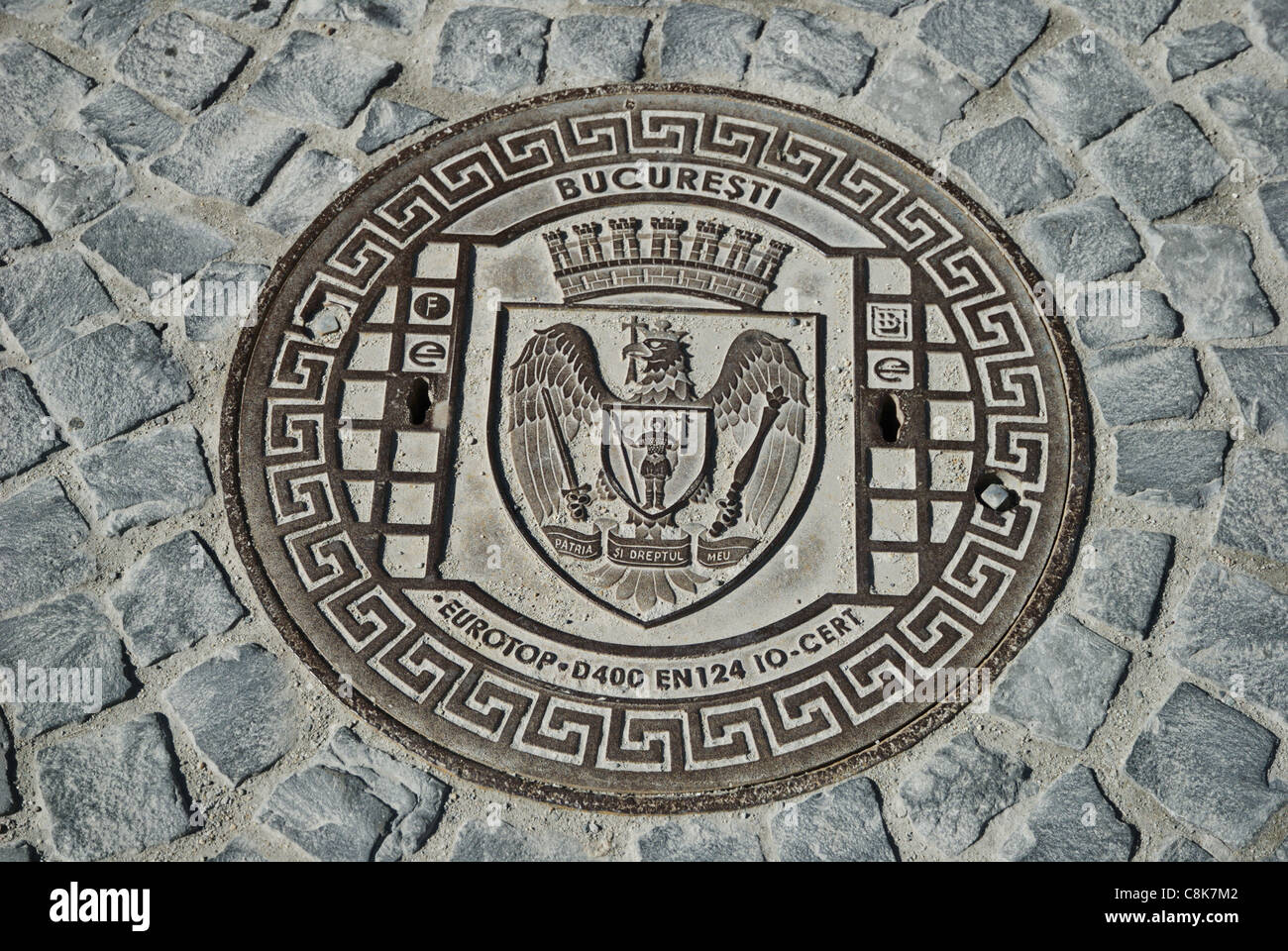 manhole cover in Bucharest, Romania - Stock Image