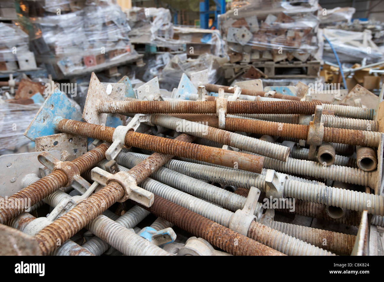 pile of used builders acro props in an old factory warehouse unit belfast northern ireland uk. - Stock Image