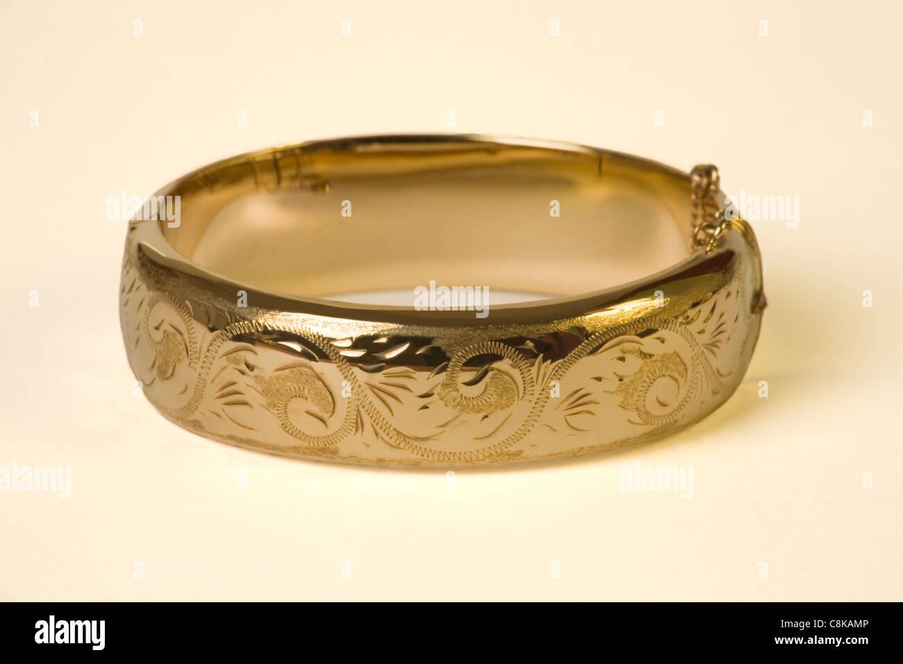 Gold bangle - Stock Image
