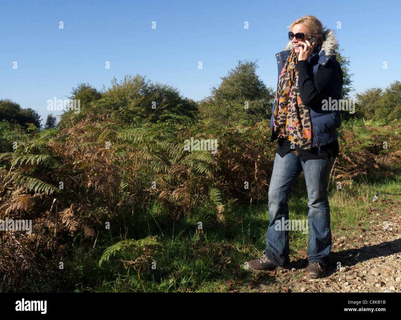 Female rambler talking on her mobile phone Stock Photo