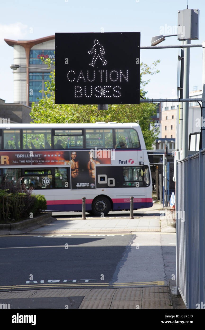 A Bus Warning sign  for pedestrians, UK - Stock Image
