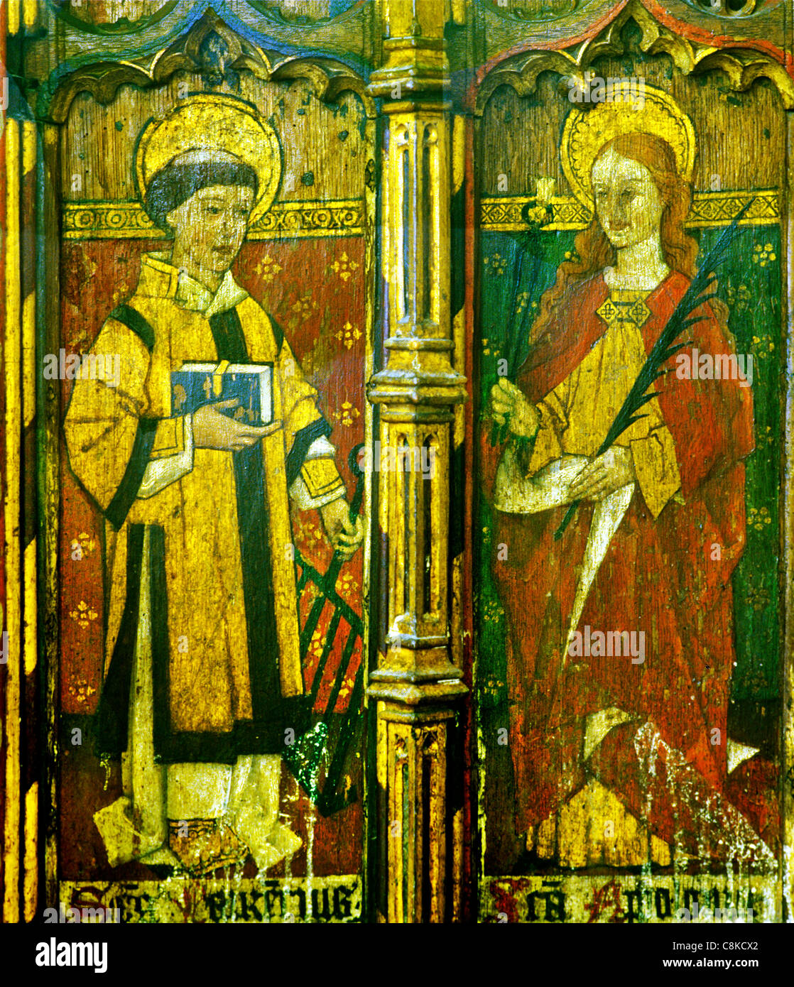 Ludham, Norfolk, rood screen, St. Laurence, Lawrence, holding a gridiron and St. Apollonia, holding pincers and - Stock Image