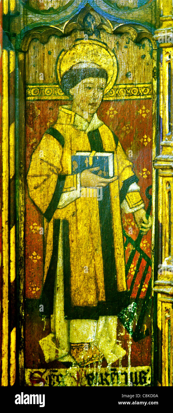 Ludham, Norfolk, rood screen, St. Laurence, Lawrence, holding a gridiron, patron saint of chefs and cooks male saint - Stock Image