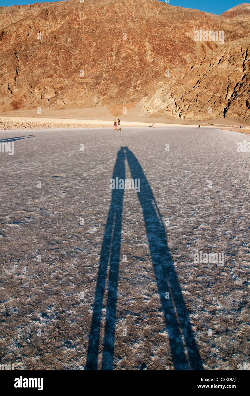 Shadow of Kissing Couple, Badwater Basic Salt Pan, Death Valley - Stock Image