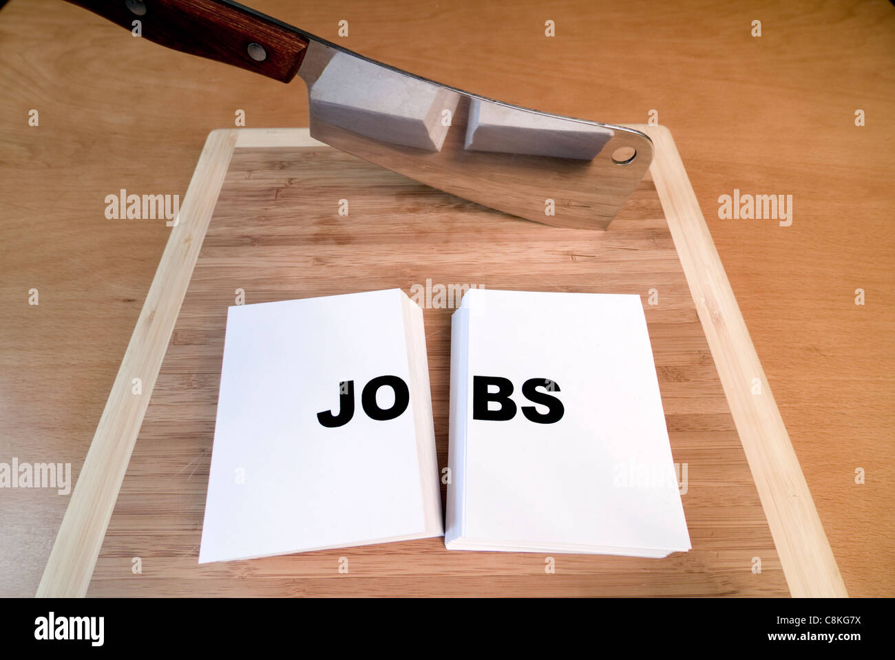 Cutting jobs with a cleaver and cutting board. - Stock Image