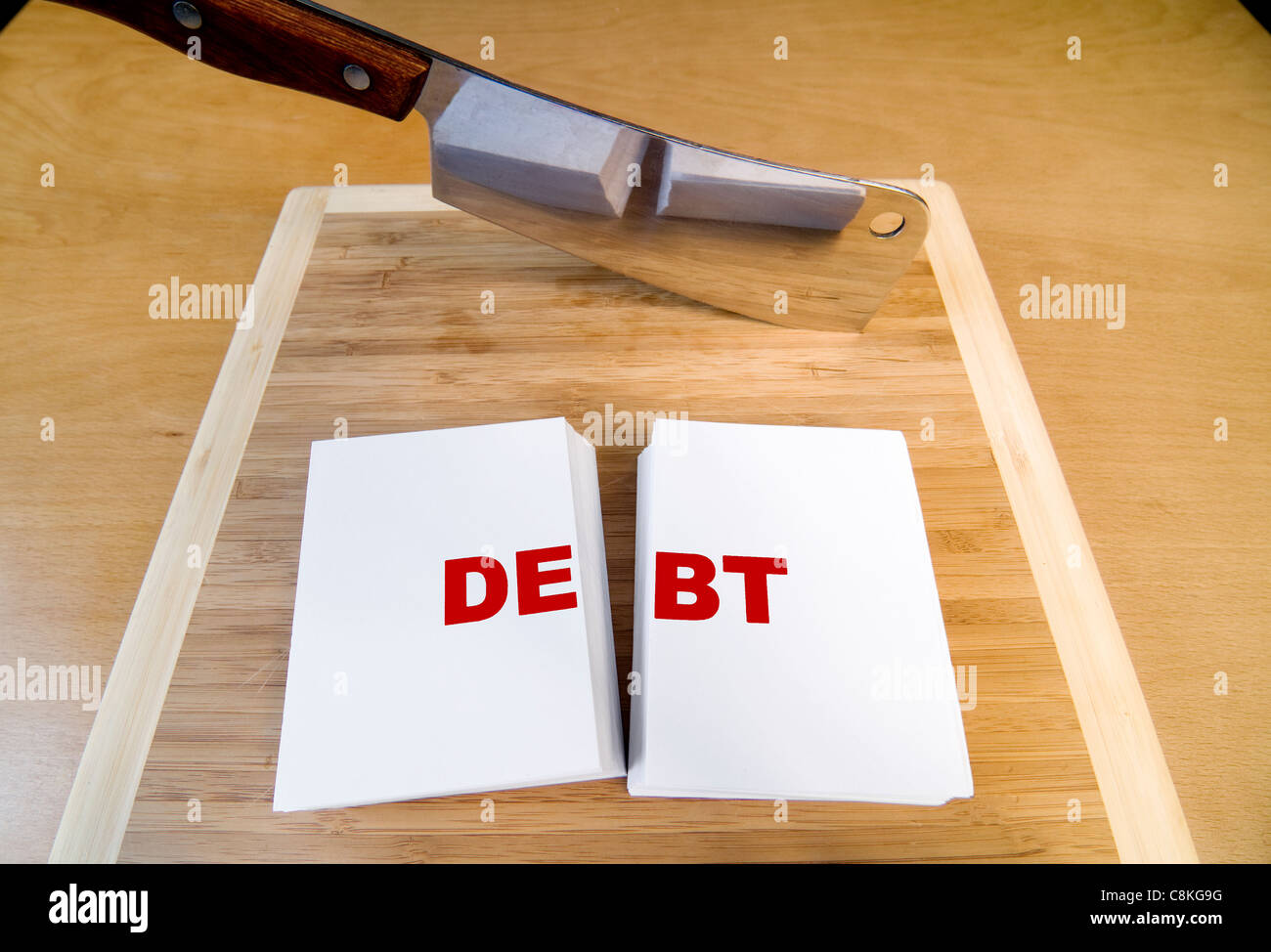 Cutting debt with a cleaver and cutting board. - Stock Image