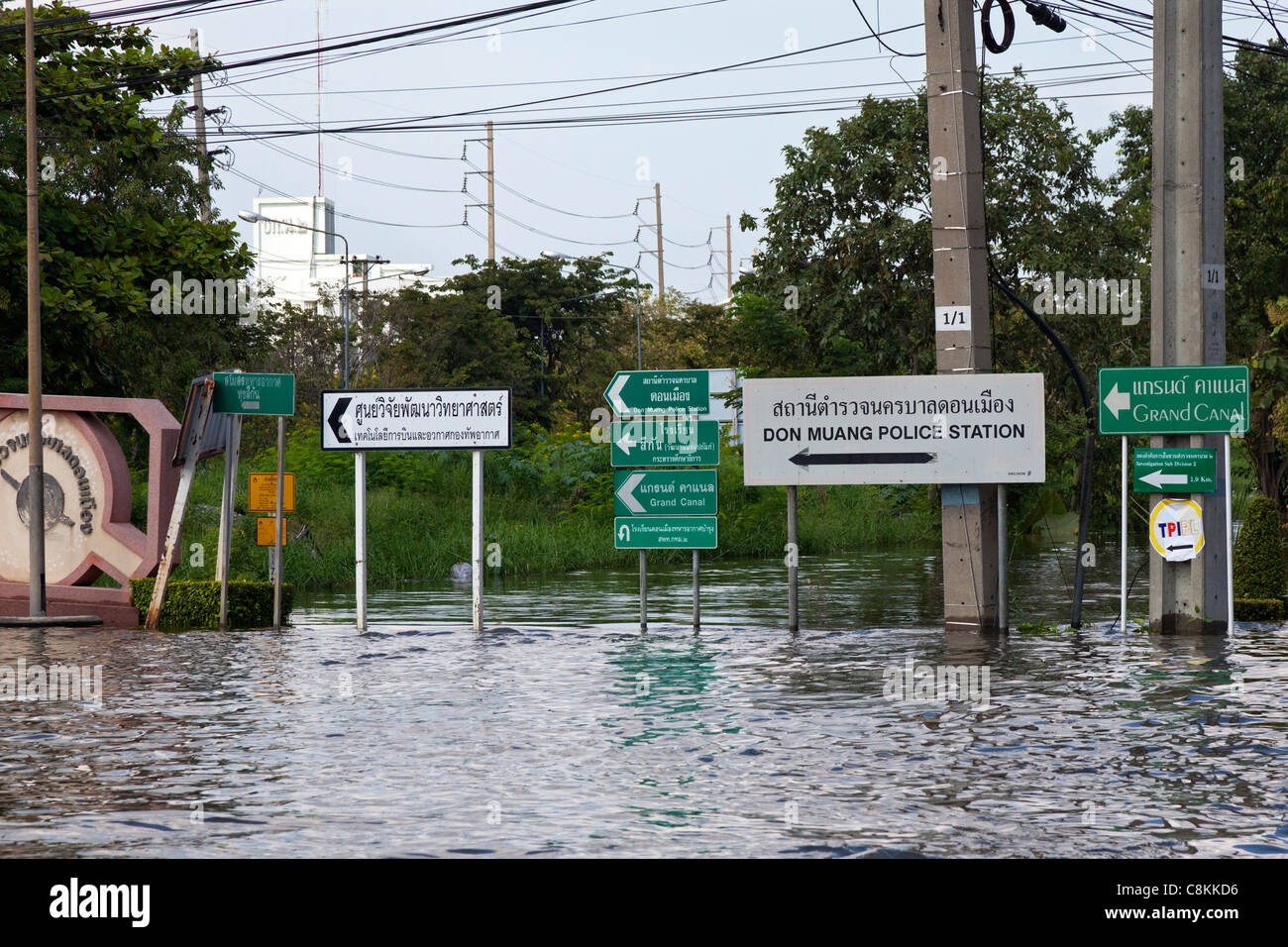 Road signs in flooded Bangkok street, Thailand - Stock Image