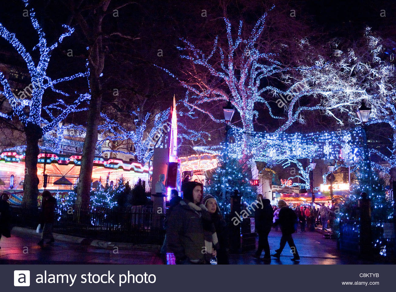 Londoners: London Street decorations at night in Leicester Square - Stock Image