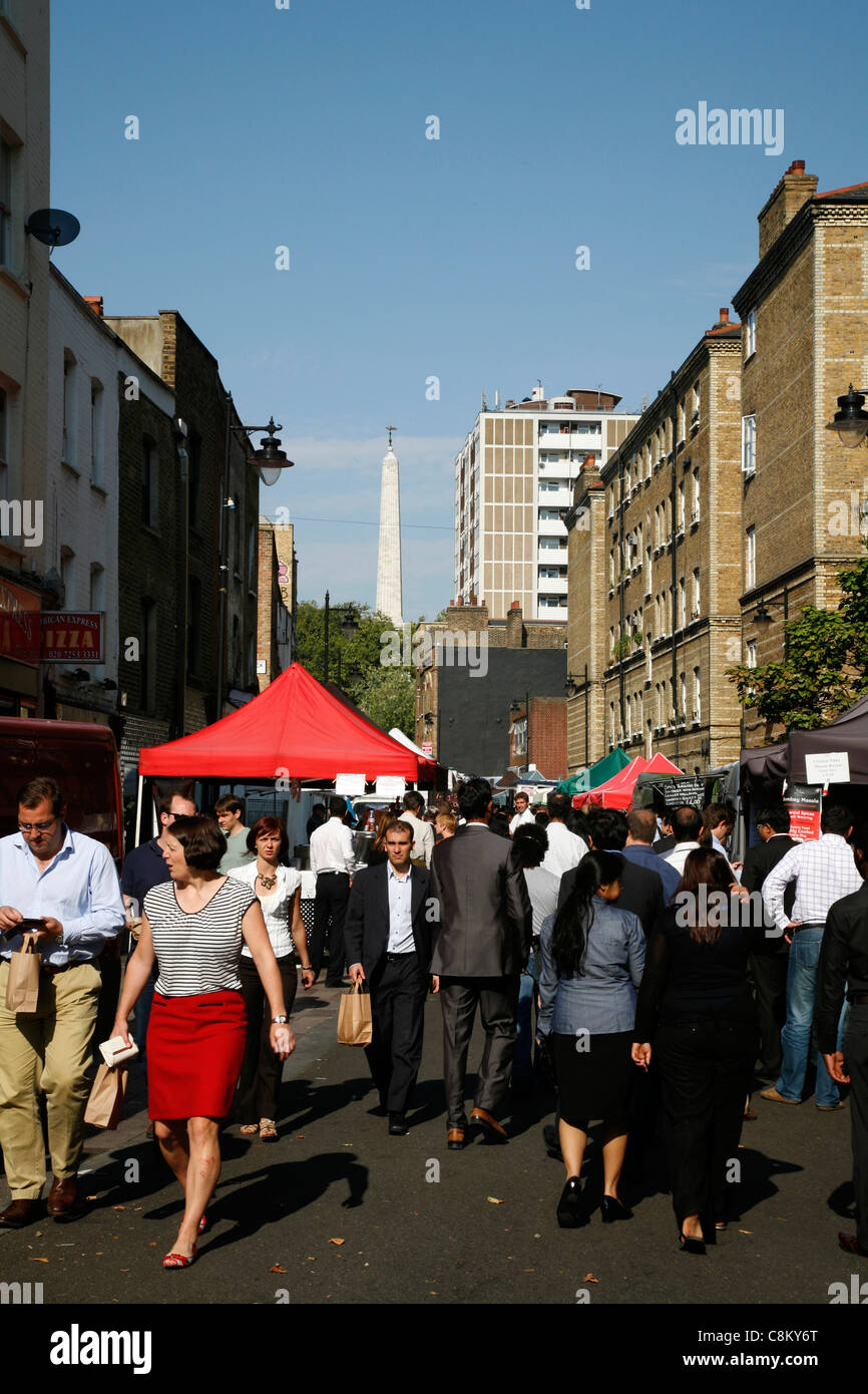 Whitecross Street Food Market, St Luke's, City of London, UK. The steeple of St Luke's church can be seen - Stock Image