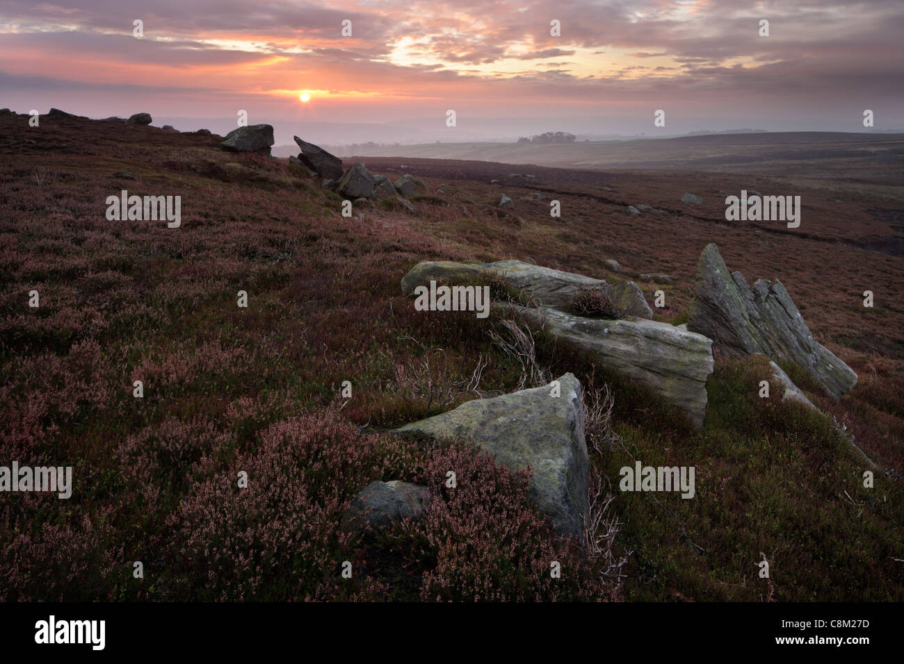 A misty autumn sunrise over Nidderdale as seen from High Crag Ridge near Pateley Bridge and Glasshouses in Yorkshire, - Stock Image