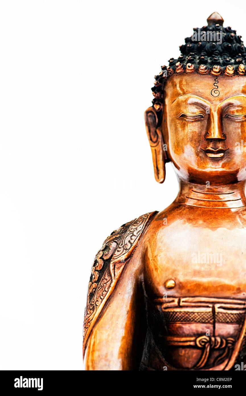 Buddha statue on white background - Stock Image