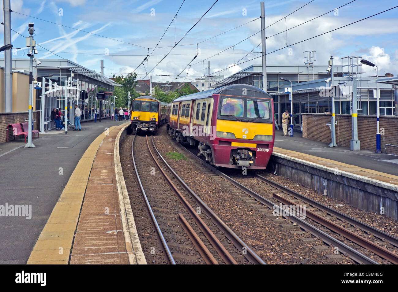 Scotrail EMU units Class 318 westbound (left) and 320 eastbound (right) passing at Partick Railway station in Glasgow - Stock Image