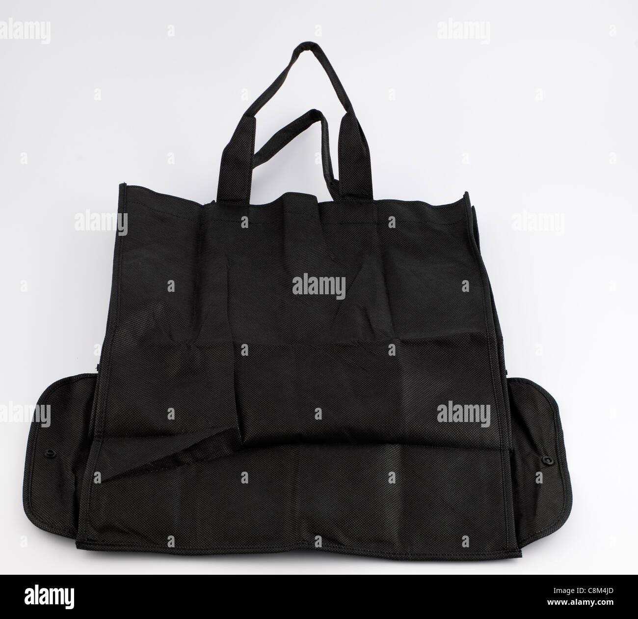 Black reusable press stud fold away handy bag - Stock Image