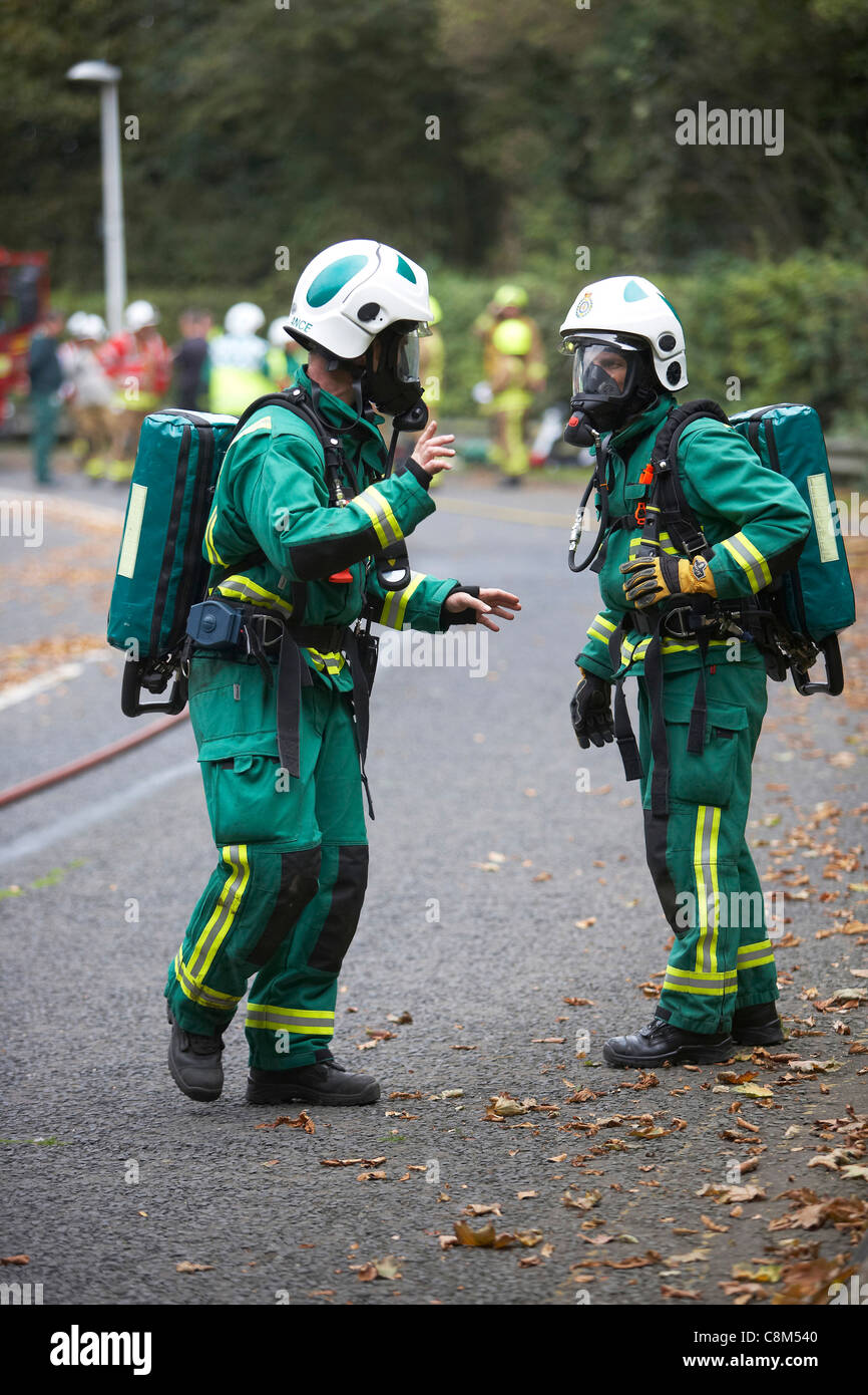 Paramedics wearing oxygen masks attend a road traffic accident simulation in East Yorkshire, UK Stock Photo