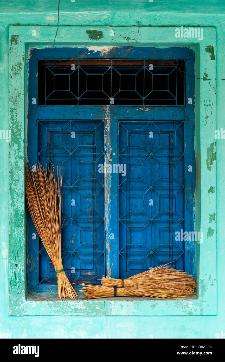 Old Indian village house / window detail with sweeping brushes on the ledge. Andhra Pradesh. India - Stock Image