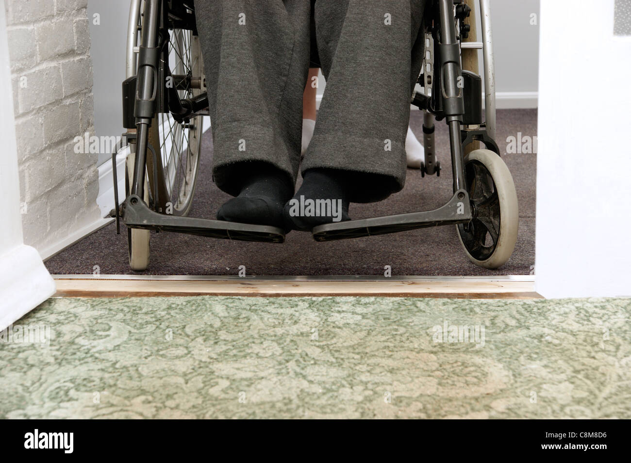 Easy access over adapted renovated flooring area from porch to hall for an elderly wheelchair user - Stock Image