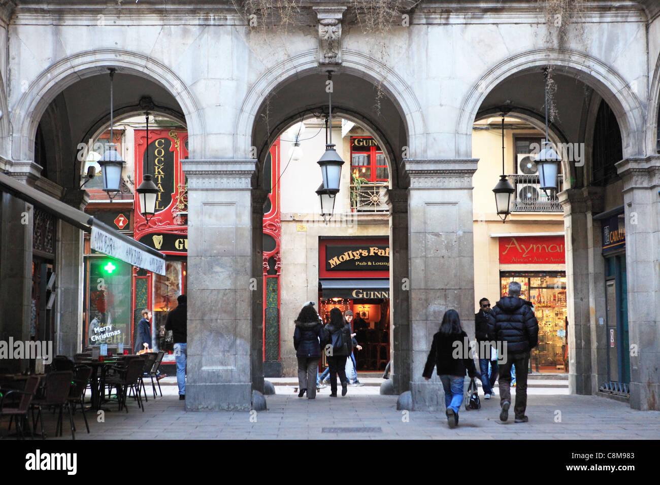 Looking through the arches from Placa Reial to Carrer de Ferran, in the Gothic Quarter in Barcelona at Christmas - Stock Image