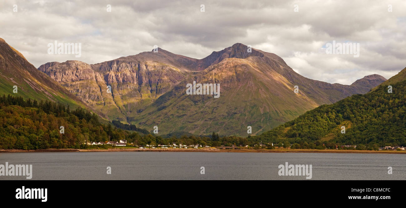 Bidean nam Bian and Glencoe village across Loch Leven - Stock Image
